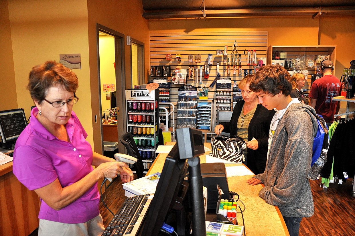 Mimi Hutton rings up textbooks Wednesday for Colorado Mountain College student Eric Cruz inside the college's new academic center. The campus will host a grand opening party for the new building at 4 p.m. Thursday.