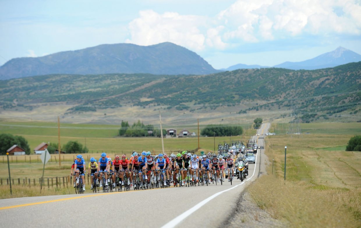 Riders work their way up an easy climb on Twentymile Road on Thursday early in Stage 4 of the USA Pro Challenge, which started in Steamboat Springs.