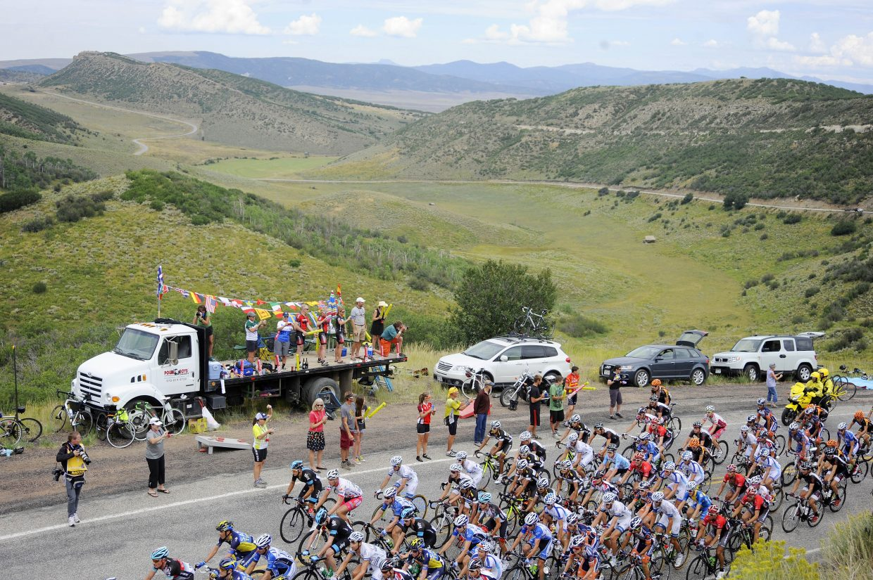Spectators watch as at the USA Pro Challenge peloton passes Thursday on Routt County Road 27 in South Routt County.