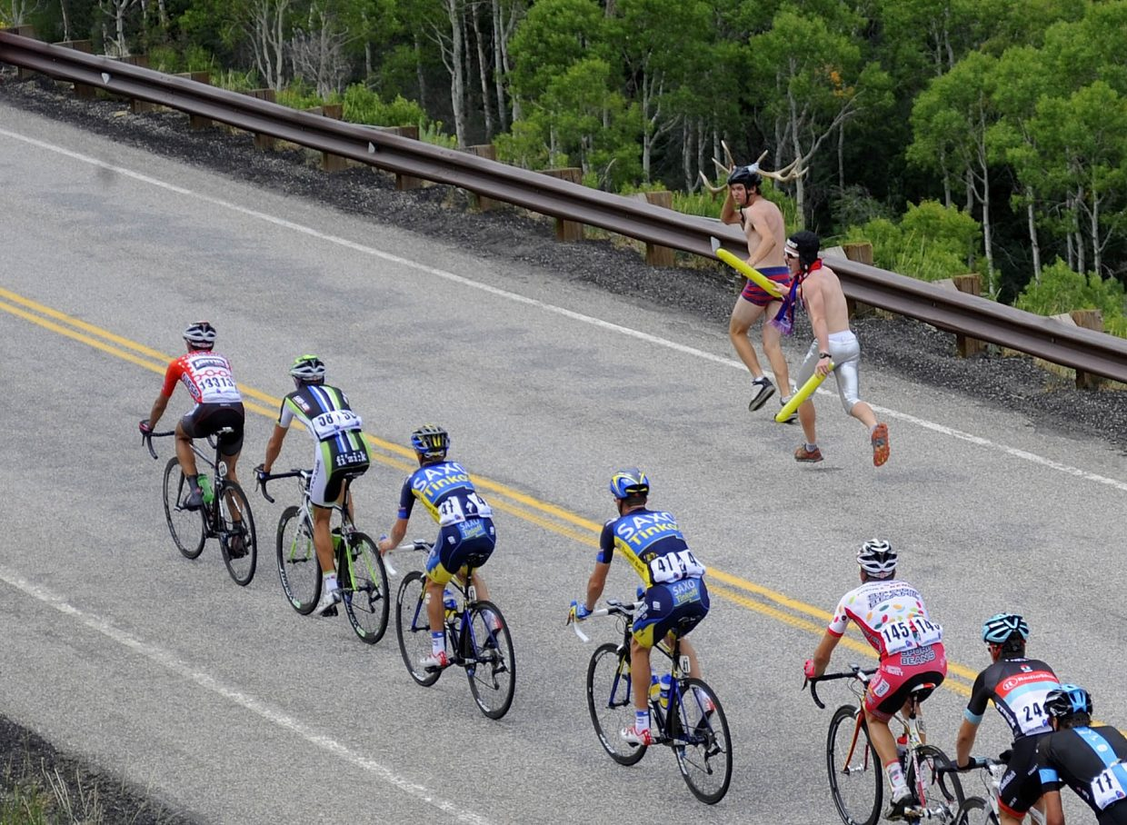 Evan Weinman holds his antlers as he chases the lead group of USA Pro Challenge riders Thursday with his friend Lars Hannah. The Steamboat youth were spectating along Routt County Road 27.