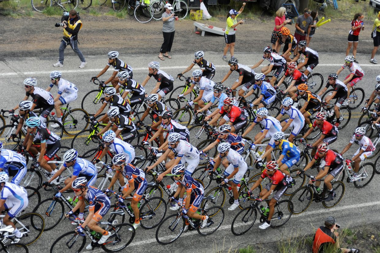 The USA Pro Challenge peloton climbs a hill Thursday on Routt County Road 27 near Oak Creek.
