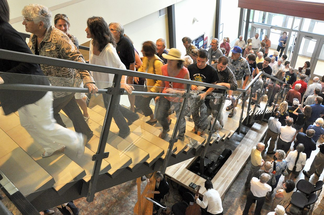 A crowd makes its way up the stairs of the new academic center Thursday night at Colorado Mountain College's Alpine Campus. Hundreds of people attended the grand opening for the 60,000-square-foot building.