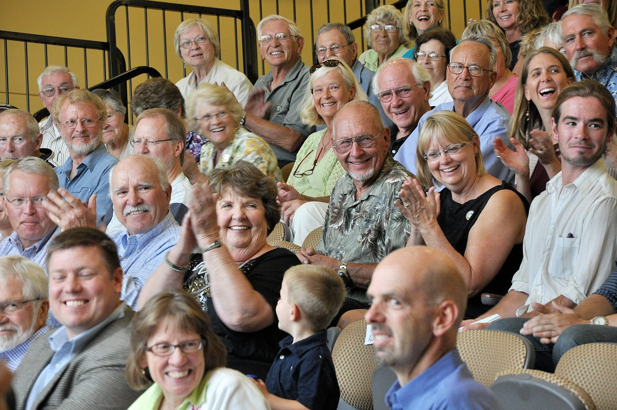Audience members applaud Thursday during a speech inside Colorado Mountain College's auditorium in the new academic center.