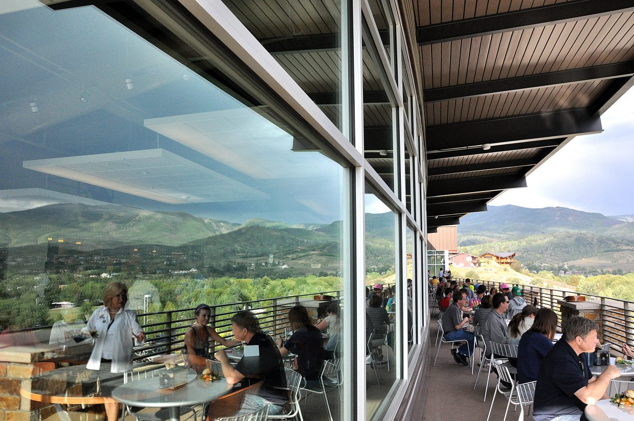 Attendees at Colorado Mountain College's grand opening party Thursday night dine on the deck of the new academic center