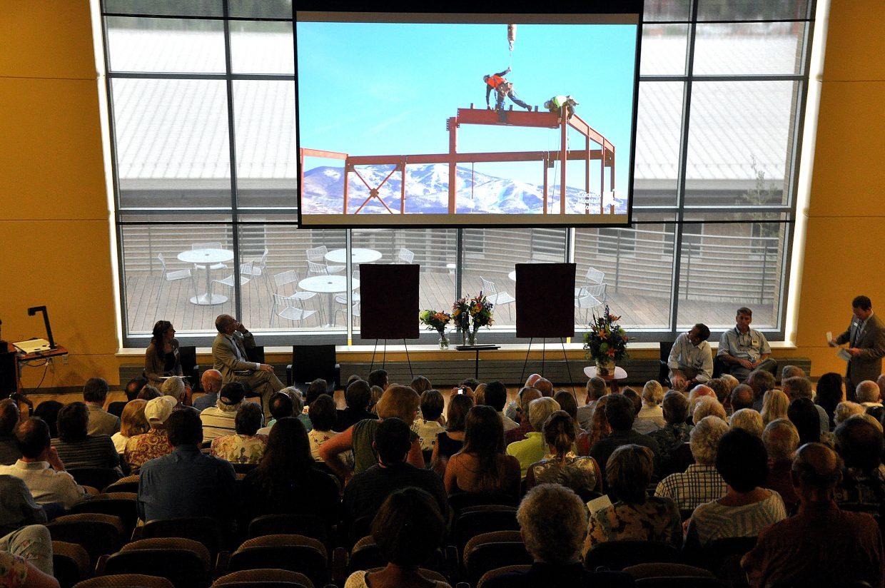 Audience members watch a video Thursday chronicling the construction of the new academic center at Colorado Mountain College's Alpine Campus.