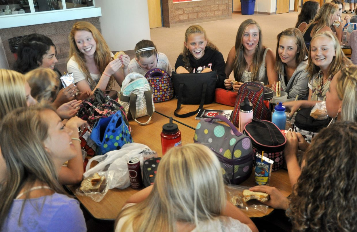 A group of freshman girls eat lunch Wednesday during their first day of school at Steamboat Springs High School.
