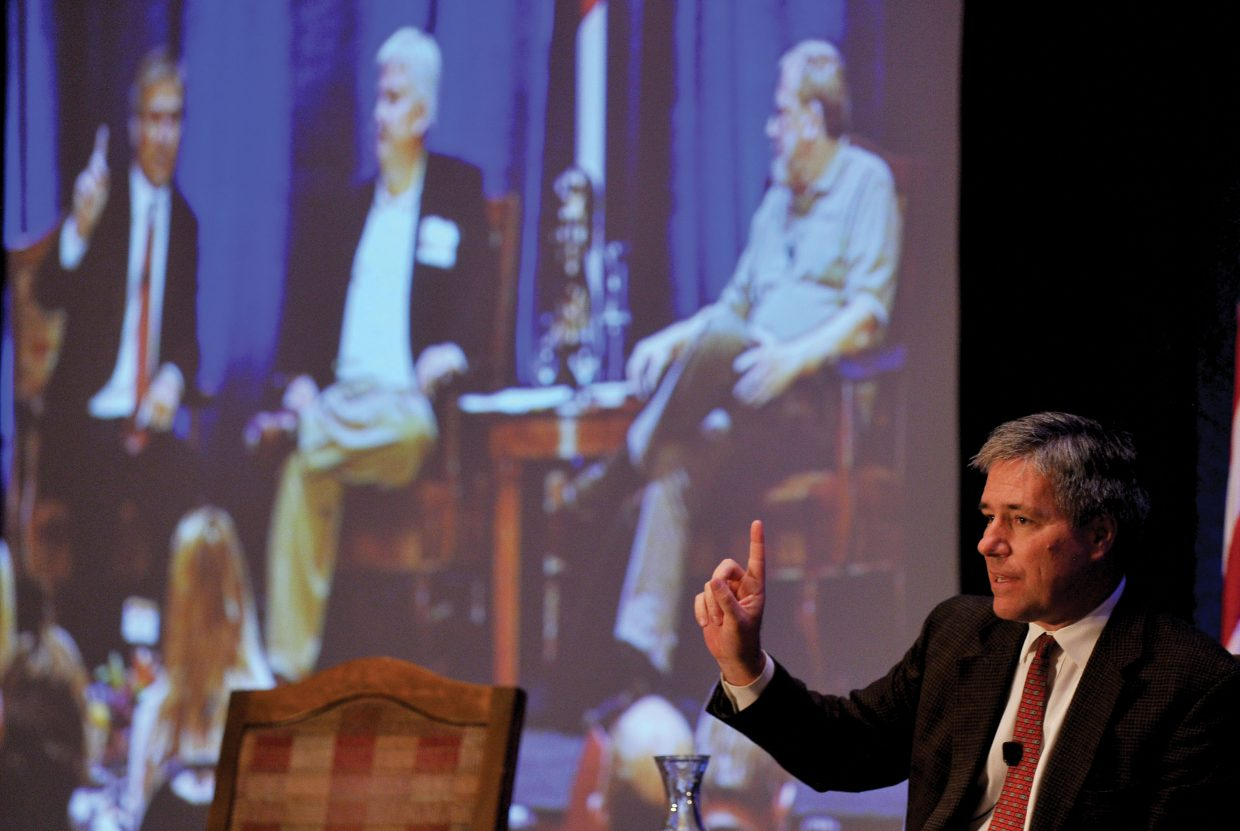 Dan Mitchell, of the Cato Institute, makes a point Friday during a debate with Professor William Black, who can be seen along with moderator Rob Douglas on the screen in the background. Both attended the event, part of the fourth annual Freedom Conference inside The Steamboat Grand Ballroom.