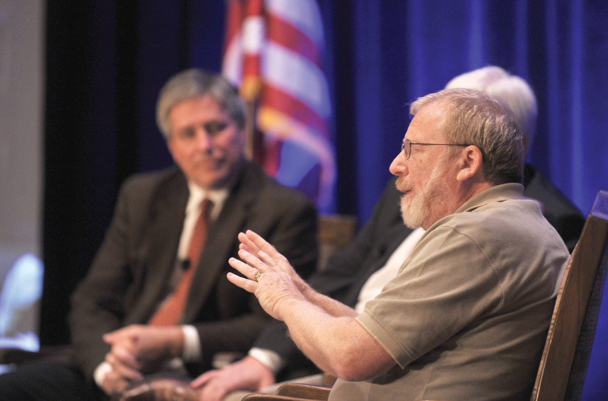 Professor William Black talks during a debate with Dan Mitchell, of the Cato Institute, during the fourth annual Freedom Conference on Friday afternoon inside The Steamboat Grand. The Freedom Conference, which opened Friday in Steamboat Springs, continues Saturday.