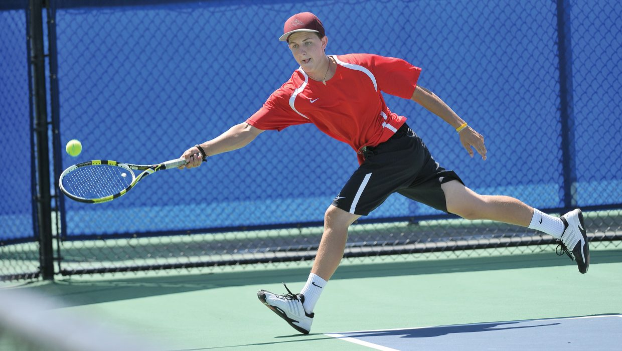 Steamboat Springs No. 1 doubles player Ben Wharton returns a shot during a match against Boulder on Friday afternoon at the Tennis Center at Steamboat Springs.