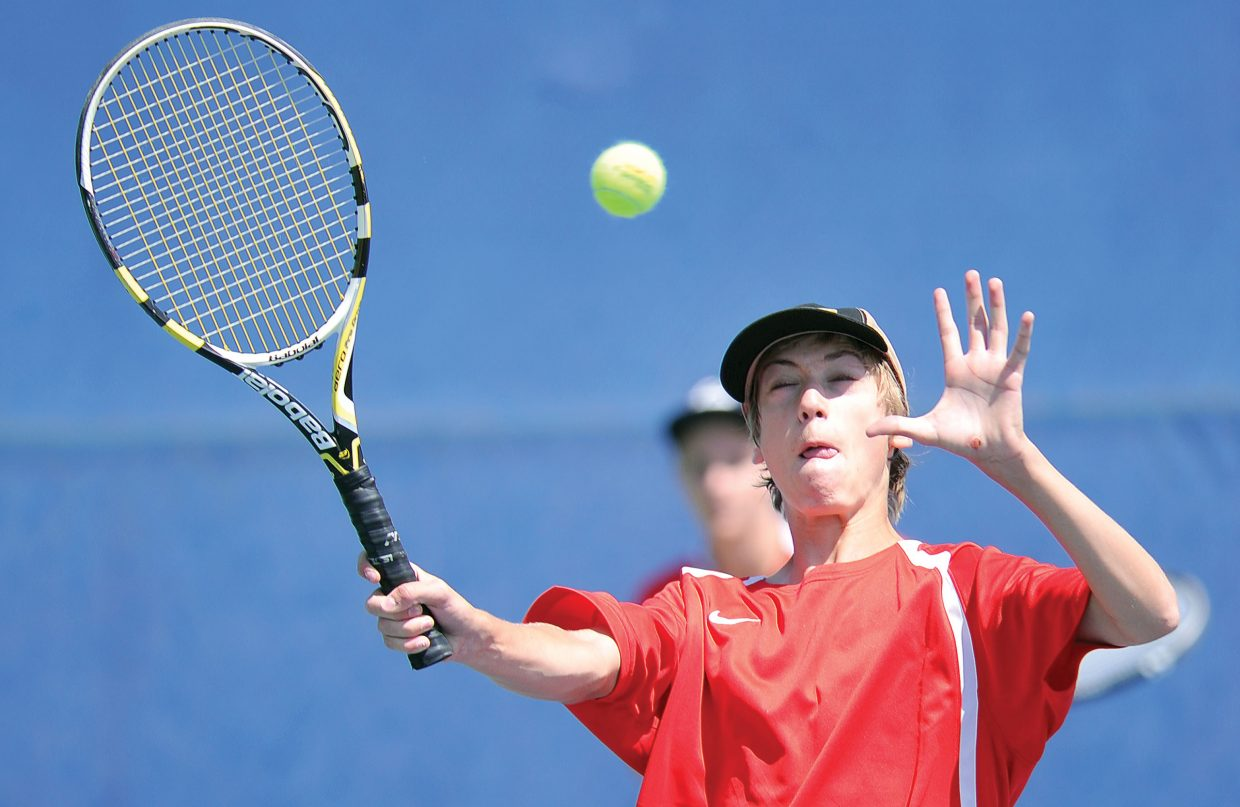 Steamboat Springs No. 2 doubles player Nick Mathews returns a shot during a match against Boulder on Friday afternoon at the Tennis Center at Steamboat Springs.