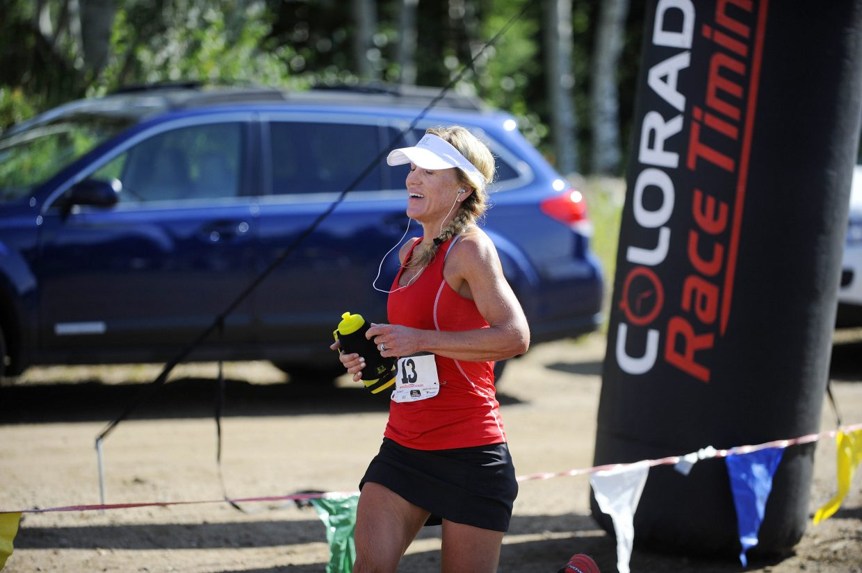 First-place female finisher Kerrie Bruxvoort, of Broomfield, crosses the finish line of the Continental Divide Trail Run on Saturday.