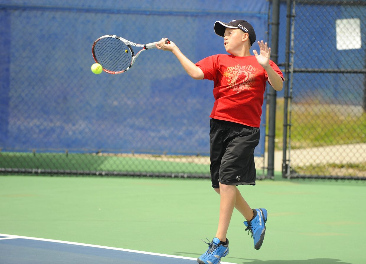 Steamboat Springs High School's Charlie Smith hits the ball during Saturday's No. 1 doubles match.