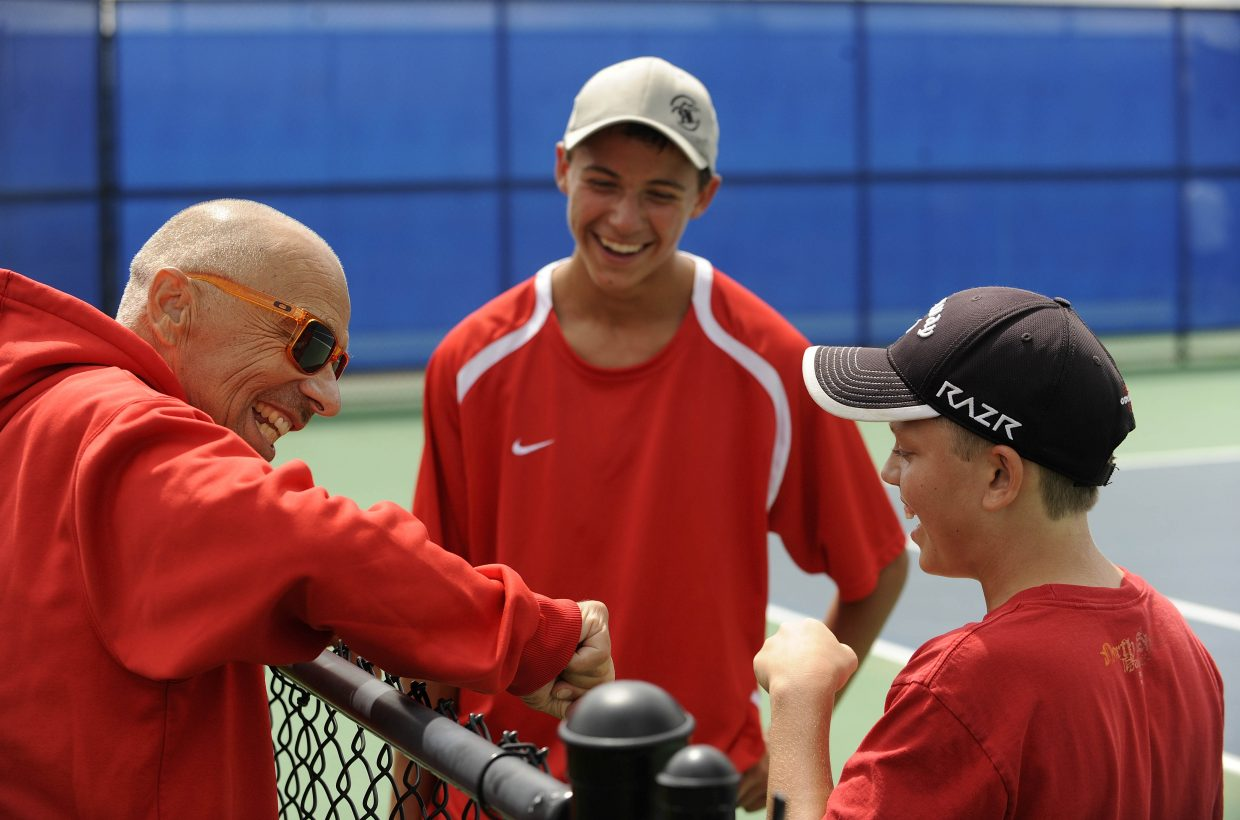 Steamboat Springs High School tennis coach Don Toy visits with doubles partners Charlie Smith, right, and Zach Dunklin during a break in Saturday's match.