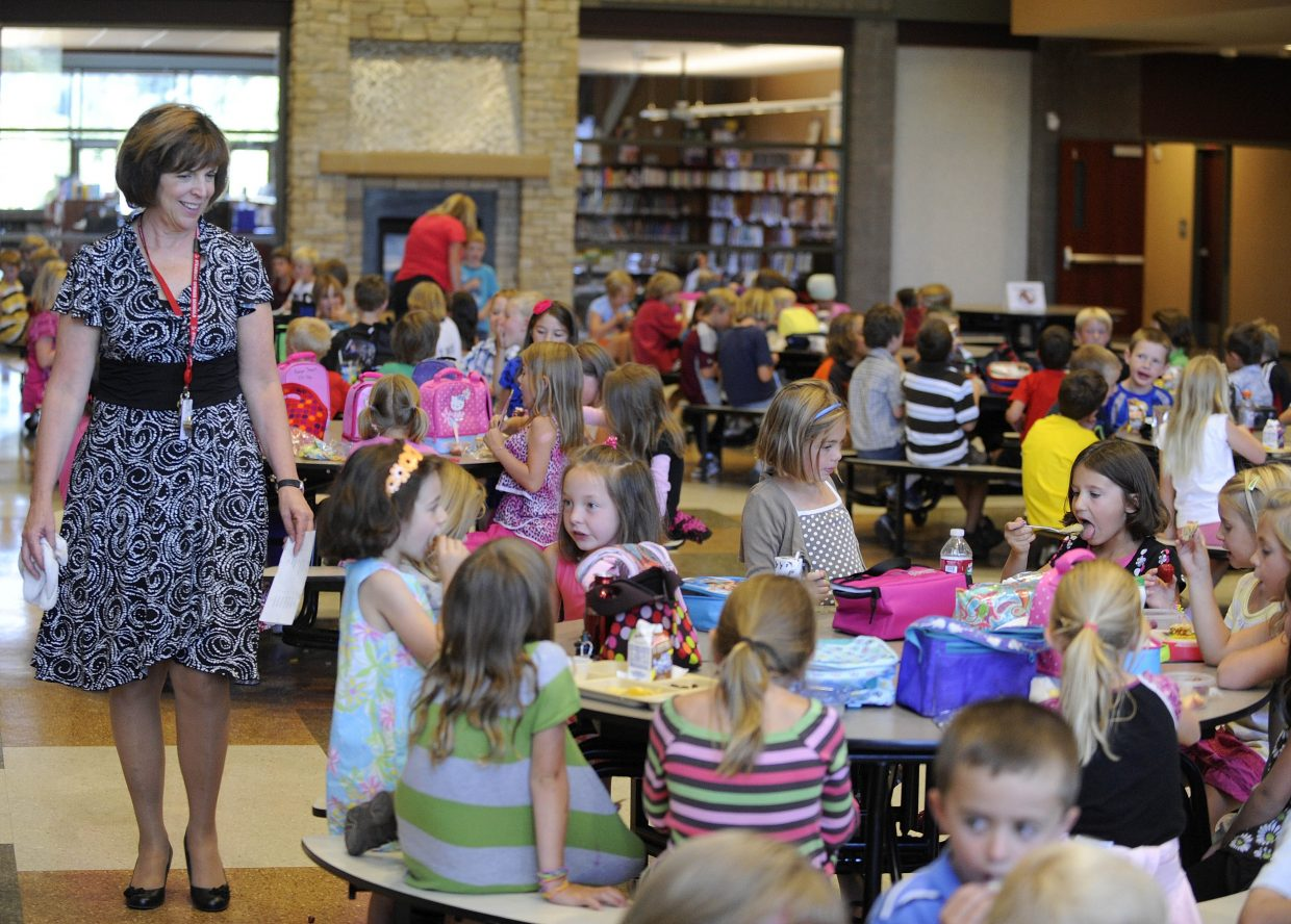 Soda Creek Elementary School Principal Judy Harris supervises lunch during the first day of school Wednesday.