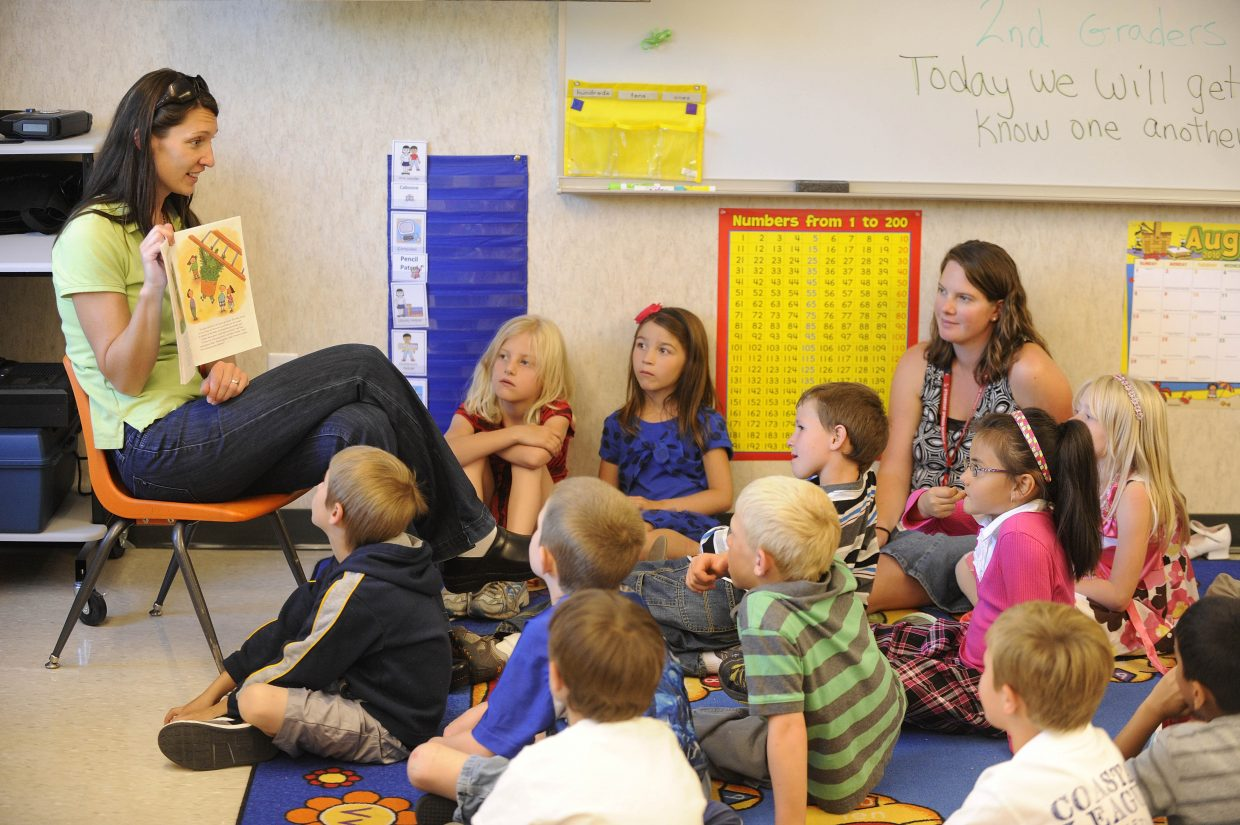 New Soda Creek Elementary School second-grade teacher Aurora King reads to her students during her first day of classes at the school.
