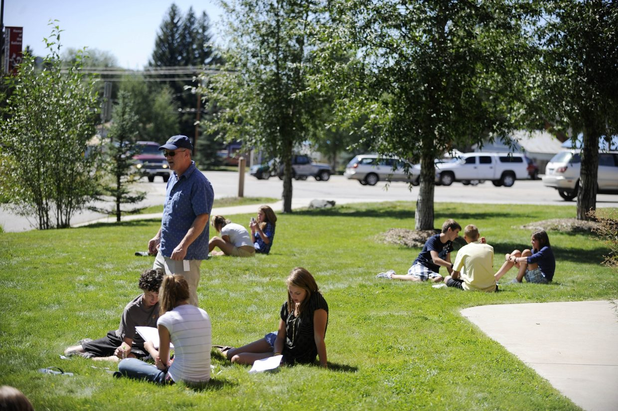 Steamboat Springs High School science teacher Nat Cooper took his students outside during the first day of school to introduce the concepts of optics.