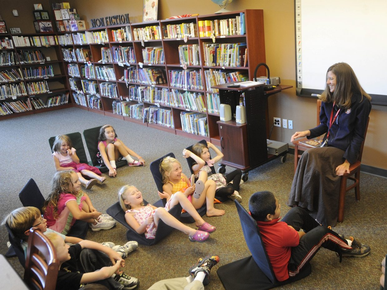 Soda Creek Elementary School librarian shares a story from the summer with first-graders during the first day of school Wednesday.