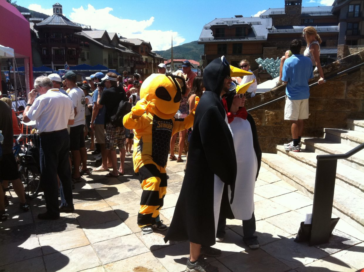 """Corey Prager, dressed as """"Buzz"""" the Honey Stinger bee, mixes it up with other costumed cycling fans Thursday in Vail for Stage 3 of the USA Pro Cycling Challenge."""