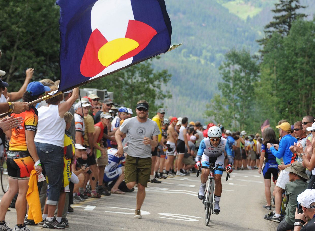 A giant Colorado state flag waves over the road Thursday during the USA Pro Cycling Challenge in Vail.