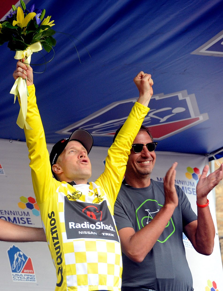 Levi Leipheimer celebrates recapturing the yellow jersey in the USA Pro Cycling Challenge on Thursday after winning the Stage 3 time trail in Vail. Leipheimer won the day's stage only by a fraction of a second — he was 0.58 seconds ahead of fellow American Christian Vande Velde — but took an 11-second lead in the race's overall standings.