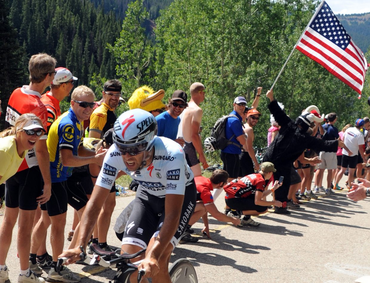 An American flag-waving gorilla cheers on riders Thursday in the USA Pro Cycling Challenge in Vail.