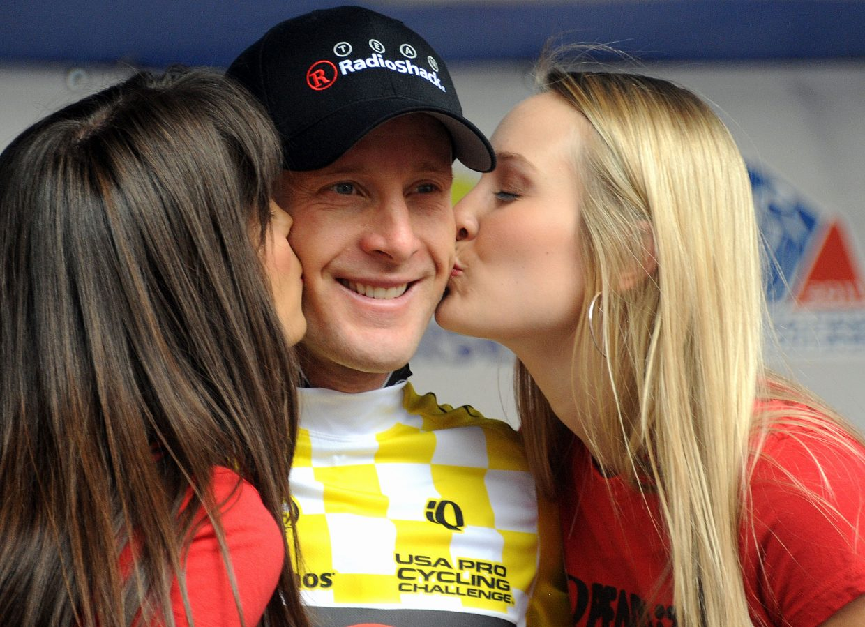 Levi Leipheimer accepts the gifts that came with his Stage 3 win Thursday in the USA Pro Cycling Challenge. Leipheimer edged out fellow American Christian Vande Velde to win the stage but took a commanding lead in the seven-day long race.