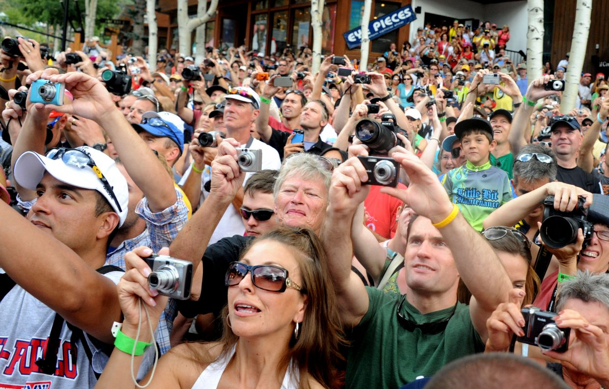 Fans photograph the yellow jersey ceremony after the third stage of the USA Pro Cycling Challenge on Thursday in Vail. Racers will arrive in Steamboat Springs today for a Stage 4 finish at Sixth Street and Lincoln Avenue downtown.