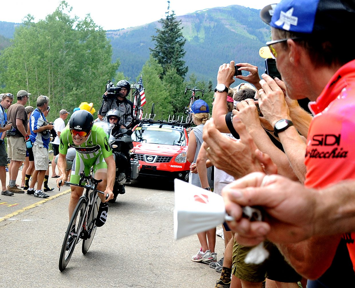 Levi Leipheimer charges through the crowd toward the finish line of the third stage of the USA Pro Cycling Challenge in Vail on Thursday. Leipheimer, who led the entire field earlier in the race, recaptured the yellow jersey with his victory in the day's time trail.