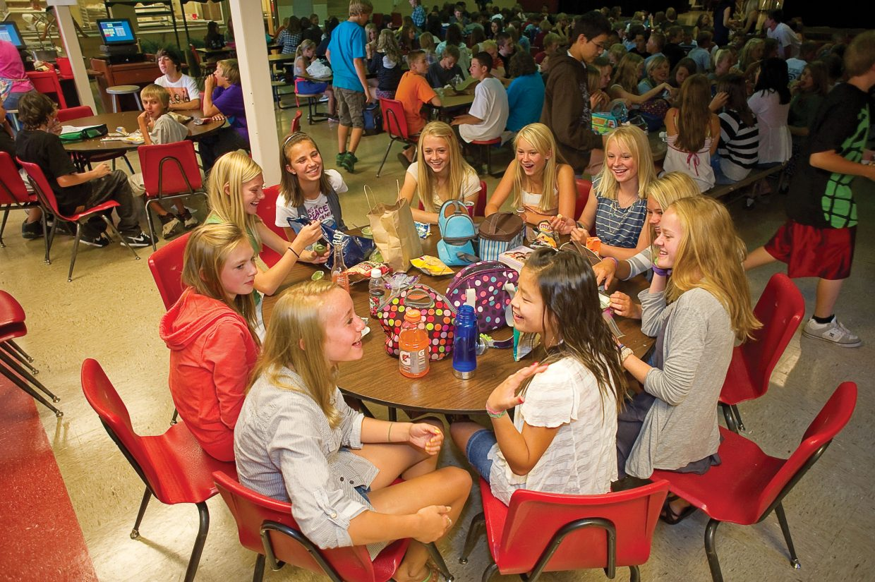 A group of eighth-grade girls visits during lunch on the first day of classes at Steamboat Springs Middle School on Wednesday afternoon.