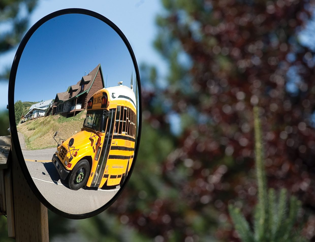 The reflection of a bus heading from the Strawberry Park Campus along Amethyst Drive on Wednesday afternoon served as a reminder that students in Steamboat Springs can only look back on the care-free days of summer now that classes have resumed in the district.