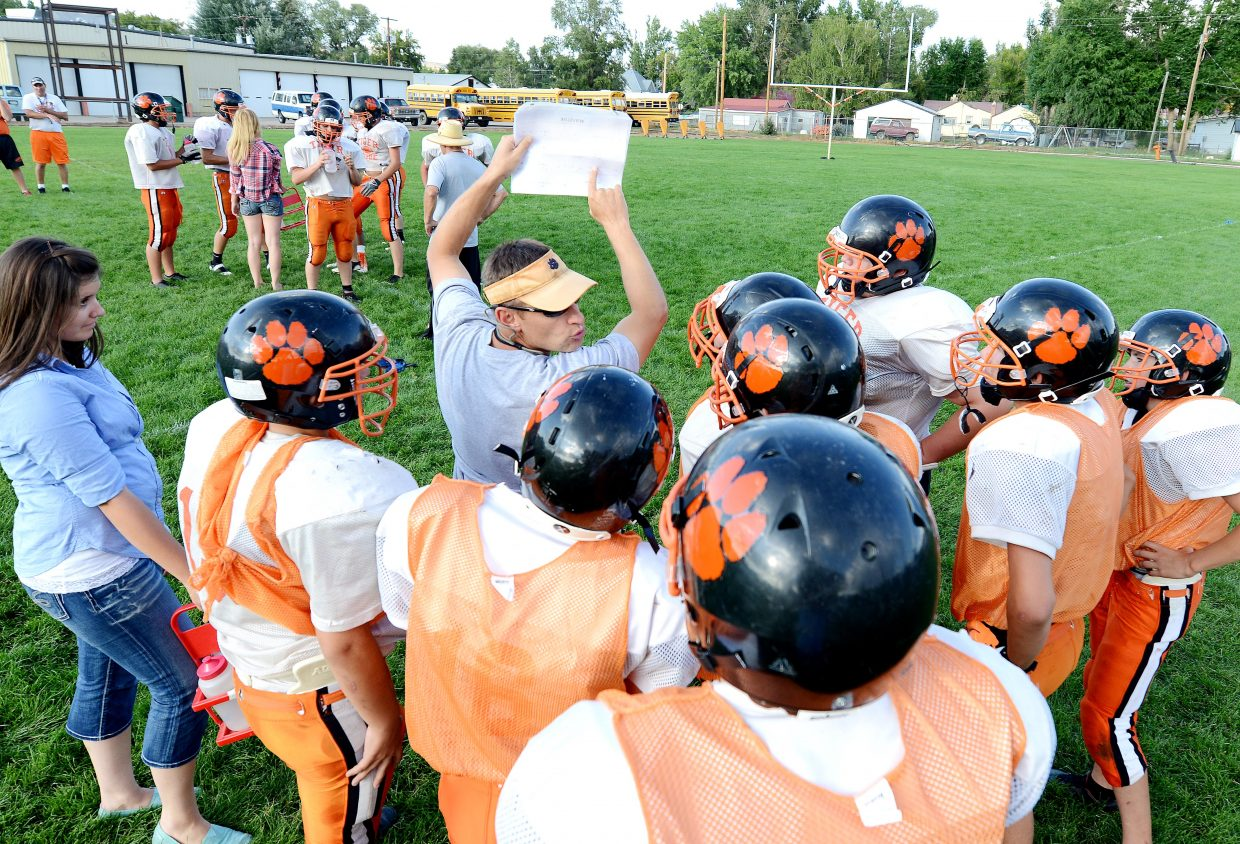 Hayden High School football coach Shawn Baumgartner points out a play Monday evening during a Tigers practice. Hayden starts its season Saturday with a trip to Belleview Christian.