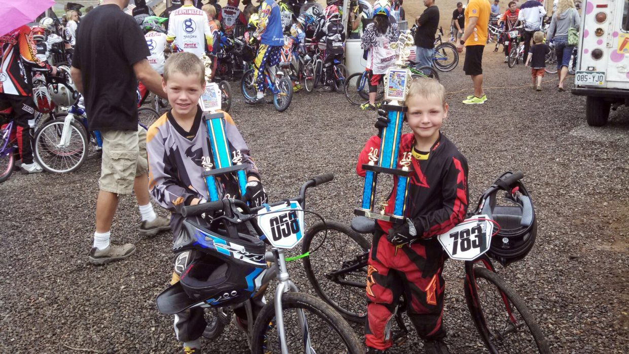 """Owen Fitzgerald, 8, and Quinn Fitzgerald, 6, show off the trophies they won at a BMX 2013 Colorado State Finals event in Grand Junction Saturday. After strong runs during the BMX season in Steamboat Springs, the Oak Creek-based racers decided to try their luck on a larger scene, and they found success there, too. Each placed second in his age division. """"We thought it would be an eye opener, but they kicked butt down there, too,"""" their father, Mark Fitzgerald said."""