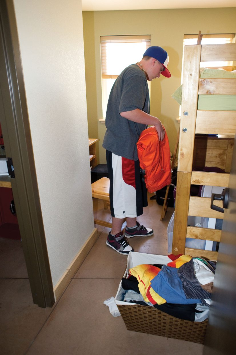 The Lowell Whiteman School student Galen Goldscheitter moves into his new room in the new boys dorm on the campus. Classes will begin Monday.