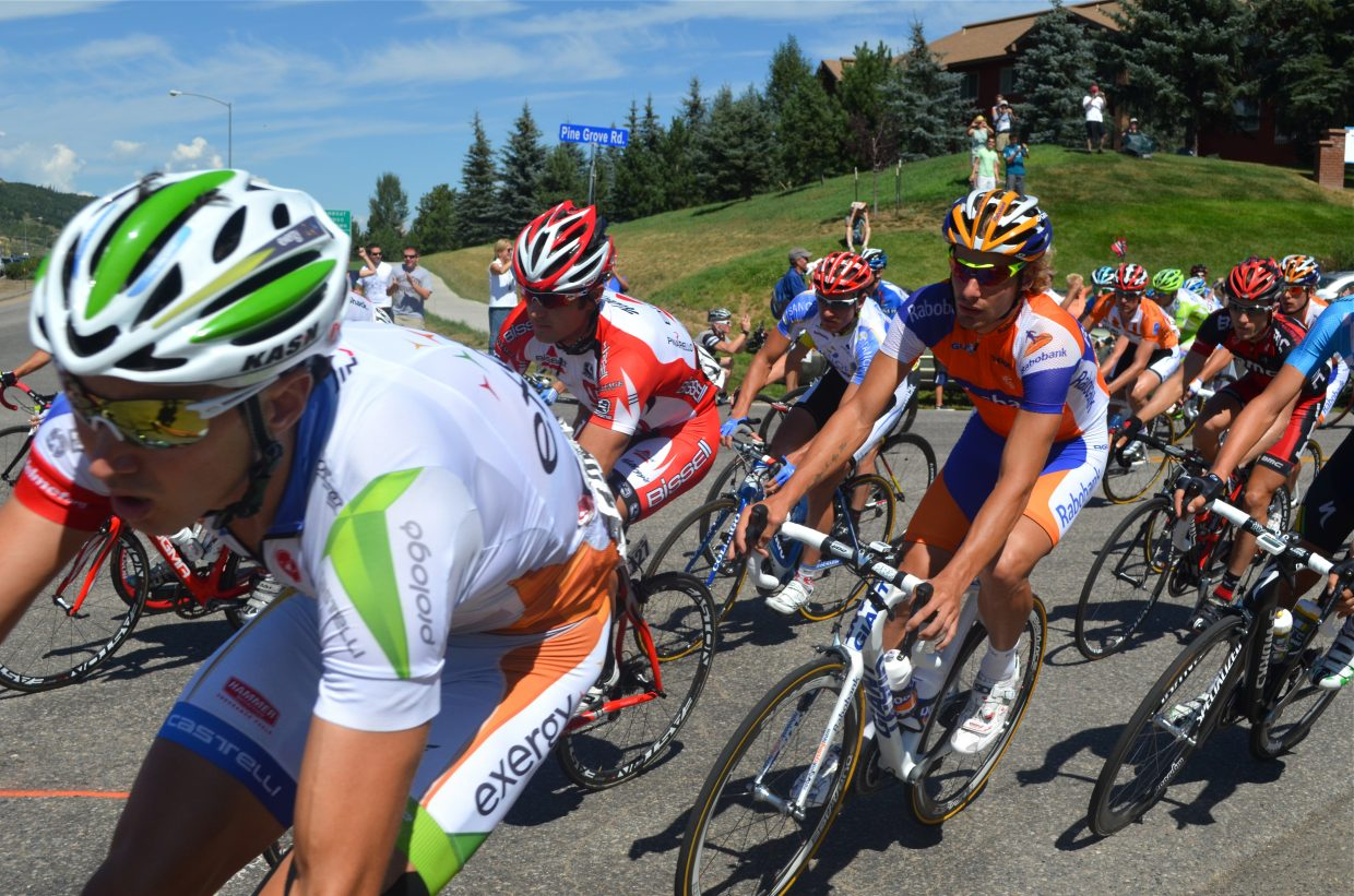 Racers turn onto U.S. Highway 40 during Stage 4 of the USA Pro Cycling Challenge on Saturday.