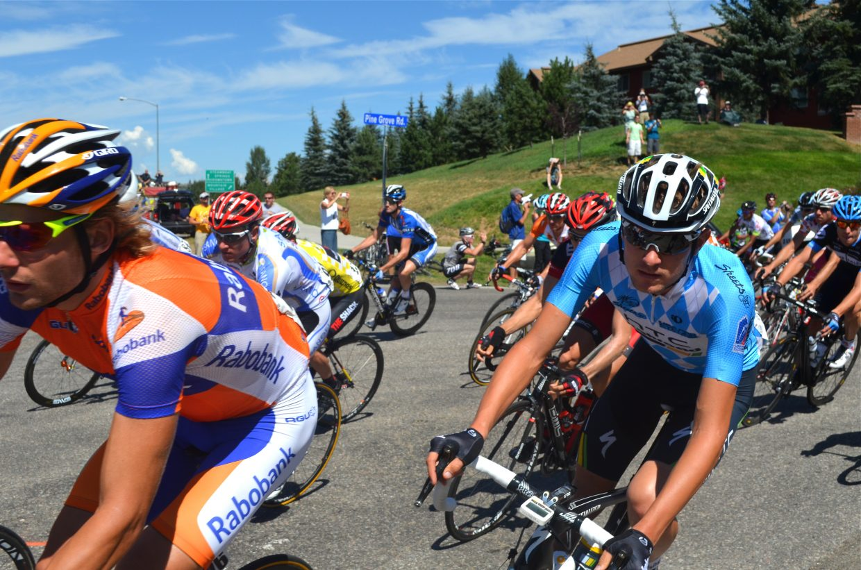 Racers turn onto U.S. Highway 40 during Stage 5 of the USA Pro Cycling Challenge on Saturday.