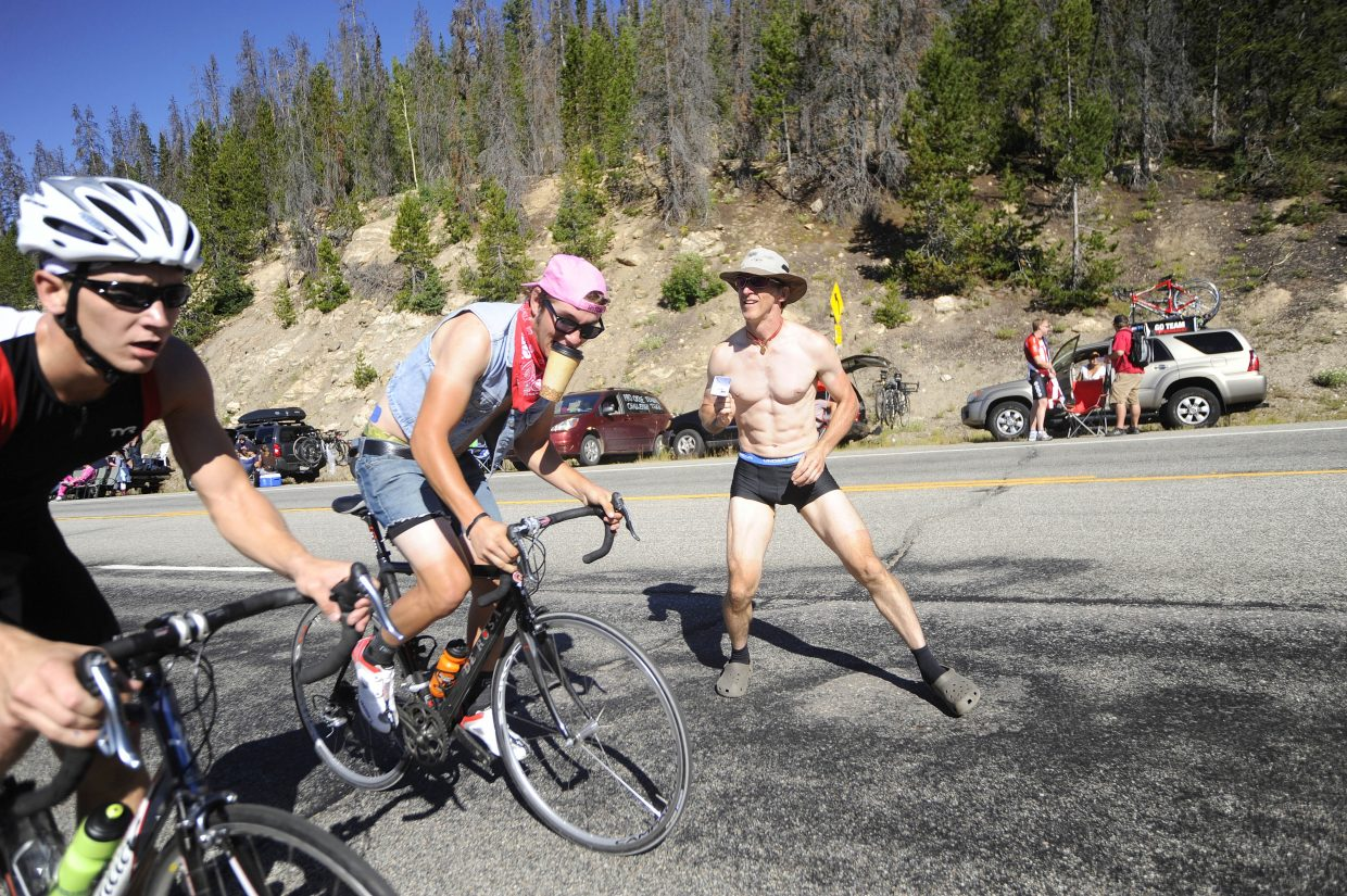 Tennessee resident Tim Thompson cheers on spectators as they climb Rabbit Ears Pass on Saturday for the USA Pro Cycling Challenge.