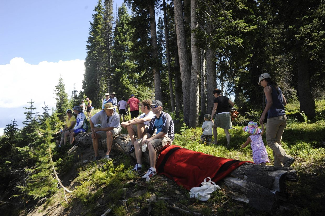Spectators wait for riders to arrive at the Rabbit Ears Pass west summit on Saturday during the USA Pro Cycling Challenge.