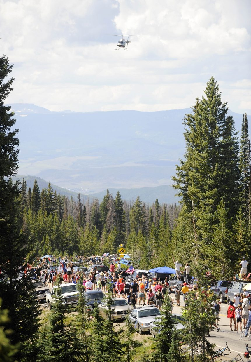 A helicopter flies over as the riders approach the top of Rabbit Ears Pass on Saturday during the USA Pro Cycling Tour.