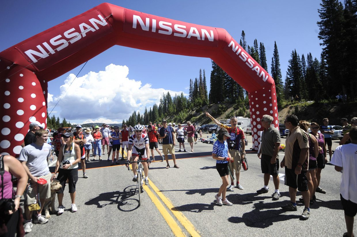 Spectators crowd around the Rabbit Ears Pass west summit on Saturday during the USA Pro Cycling Tour.