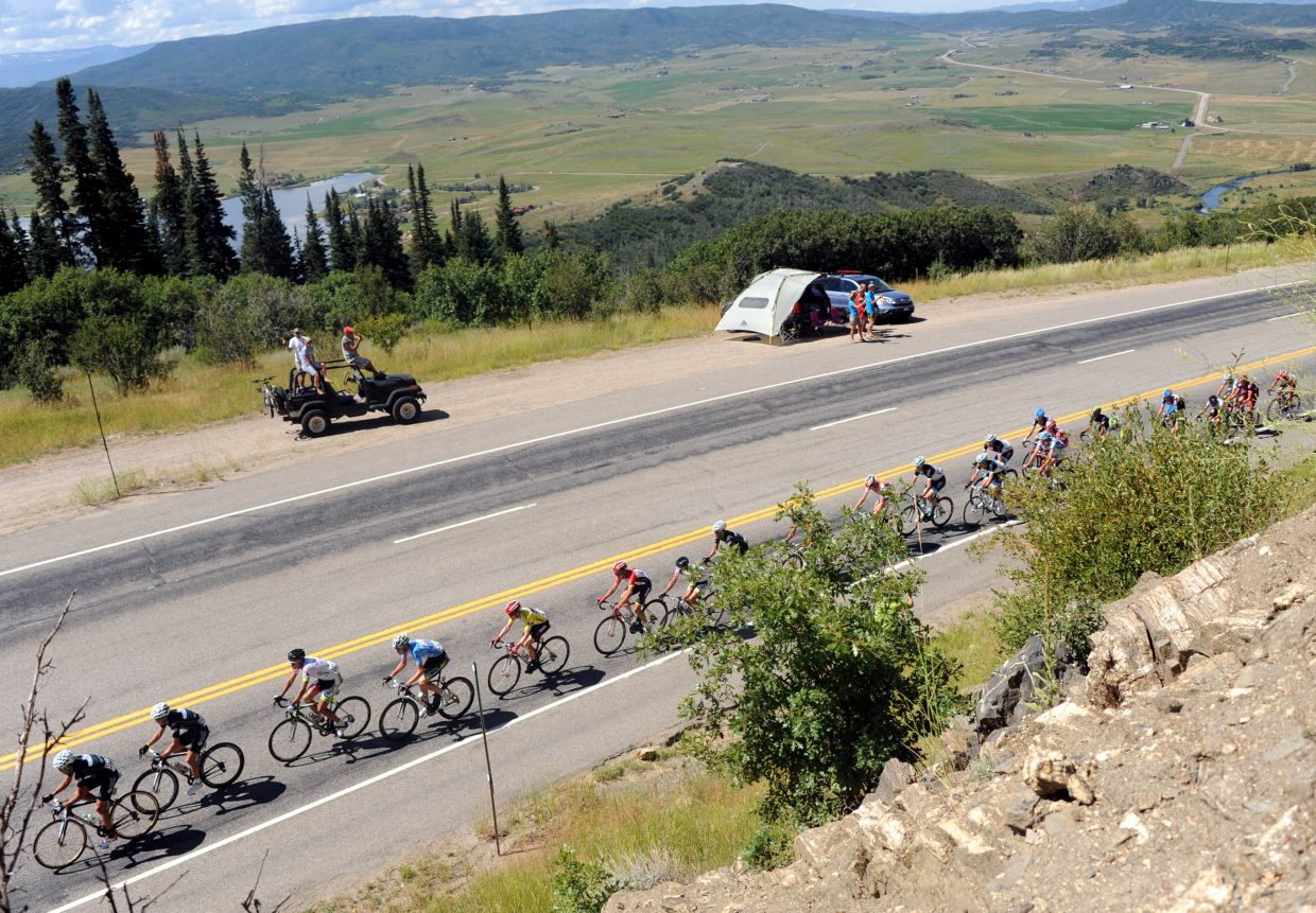 The leading edge of the peloton pedals up Rabbit Ears Pass above the Yampa River Valley on Saturday outside Steamboat Springs.