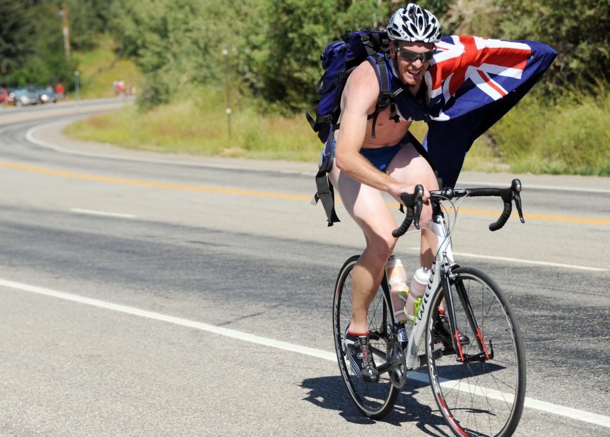 A fan heads up Rabbit Ears Pass ahead of the USA Pro Cycling Challenge on Saturday.
