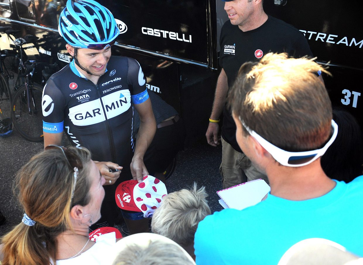Daniel Summerhill, of Team Garmin-Cervelo, signs an autograph Satuday before the Stage 5 start of the USA Pro Cycling Challenge in Steamboat Springs.
