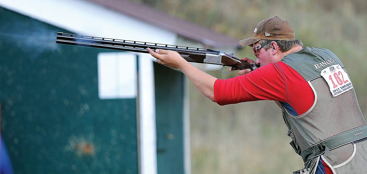 Logan Bankard fires a shot at the Routt County Rifle Club on Monday evening.