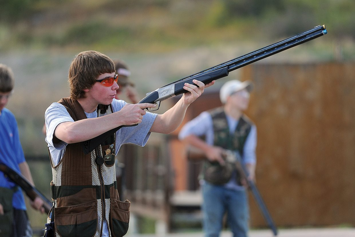 Hunter Mihaich watches as his shot hits the target while practicing at the Routt County Rifle Club on Monday.