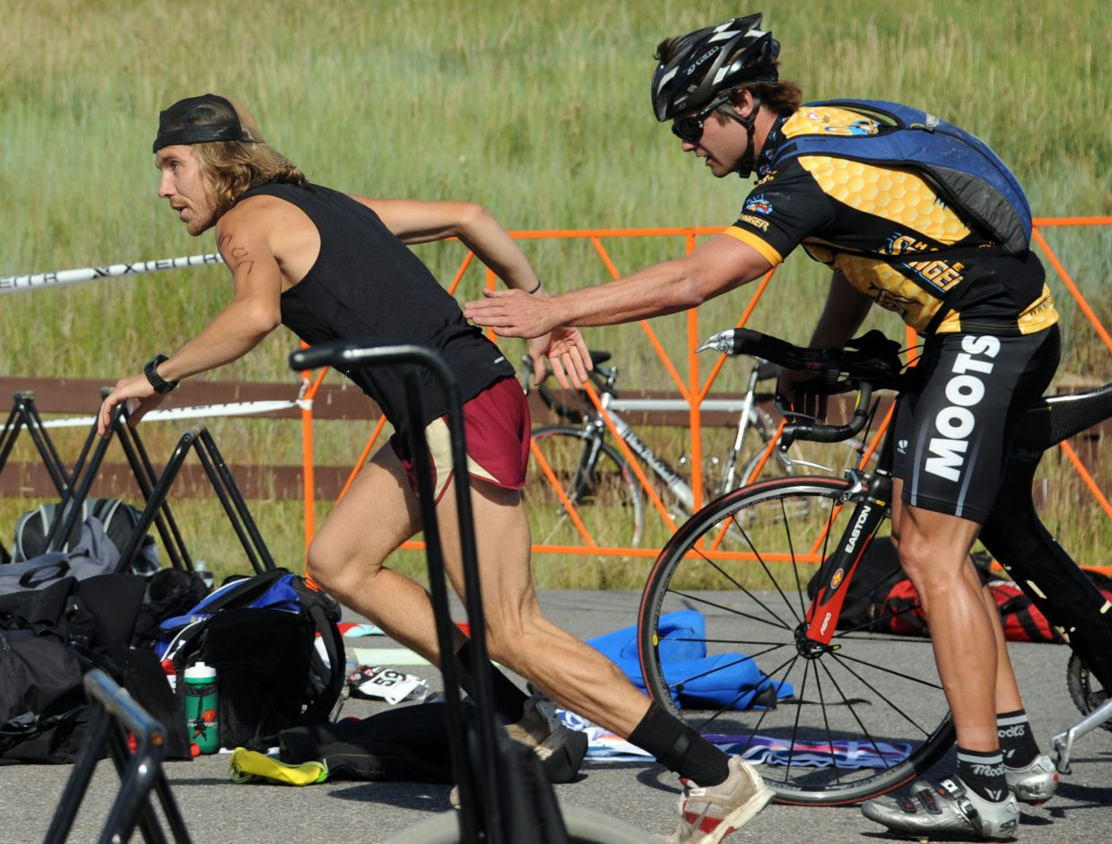 Nicholas Sunseri flies away from Brad Bingham on Sunday during the Steamboat Springs Triathlon. The pair were a part of the Honey Stinger relay team, which dominated the race, beating all the other teams and recording the day's fastest time among all competitors.