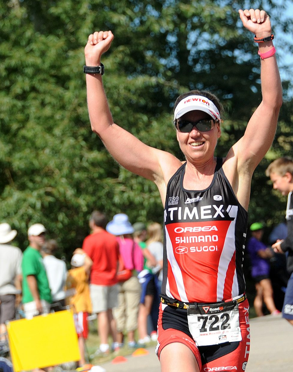 Steamboat Springs Triathlon women's champ Wendy Mader throws up her arms as she nears the finish line of Sunday's race. The long-time triathlon veteran competed in Steamboat for the first time.