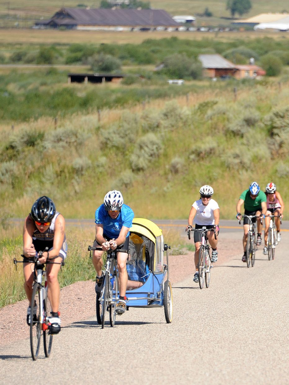 Riders make their way to Lake Catamount on Sunday during the Steamboat Springs Triathlon.