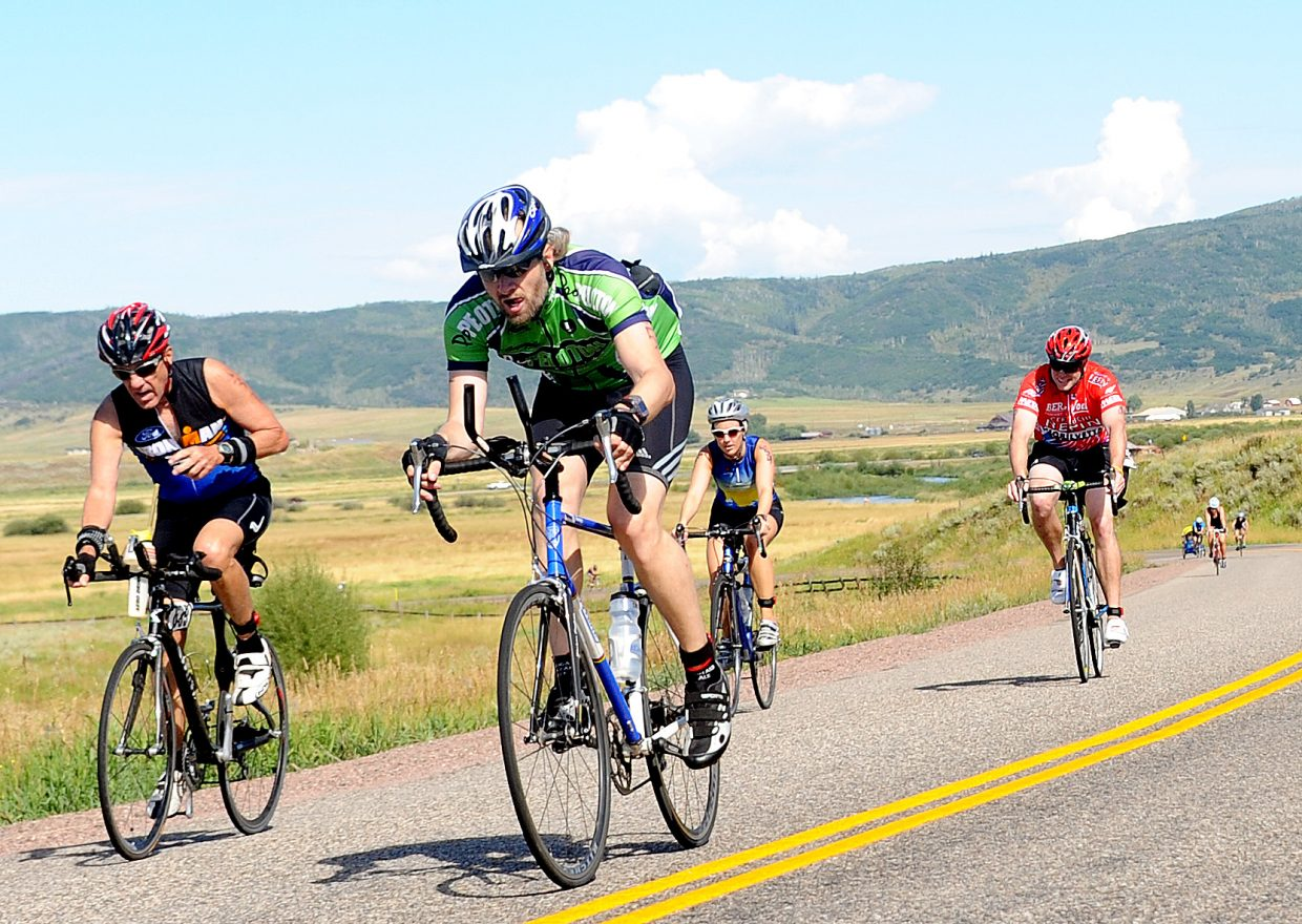 Mark Sheel, in green, leads a pack of rides Sunday in the Steamboat Triathlon.