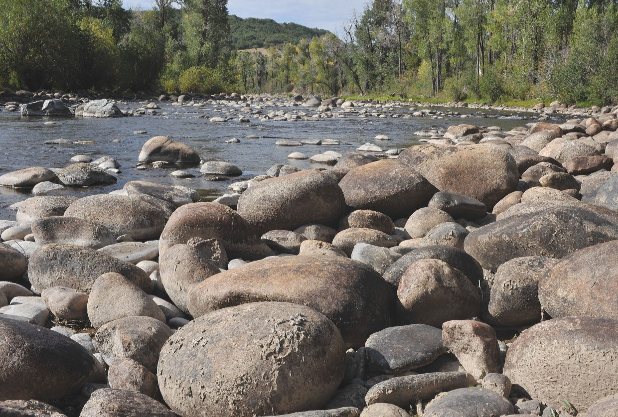 Large boulders lie exposed on the banks of the Elk River just north of Steamboat Springs this week. This year's mild winter and limited summer moisture have resulted in lower-than-typical river flows in the area.