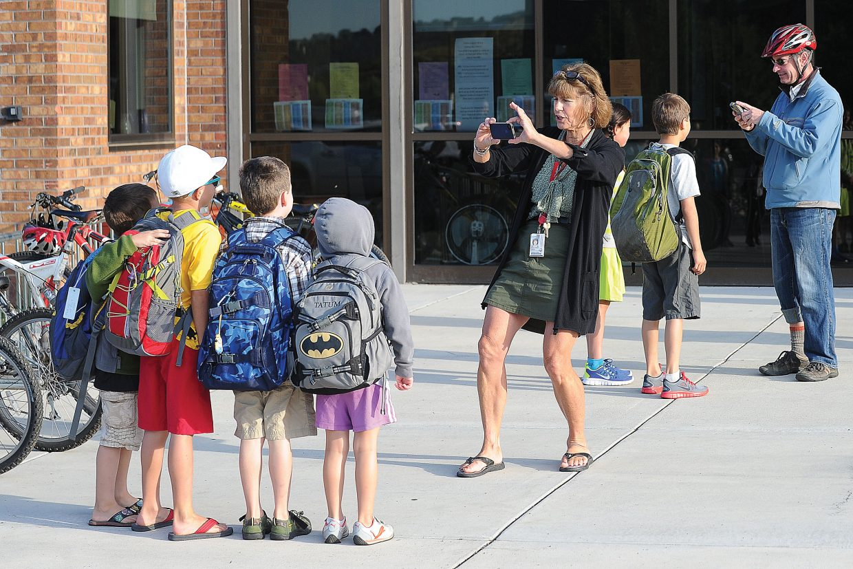 Strawberry Park Elementary School librarian Sherry Holland stops a group of students to take a picture Wednesday on the first day back to school.